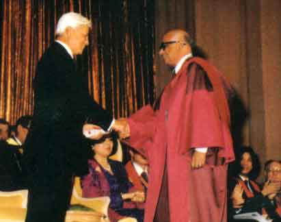 Ybhg Tan Sri Prof. T.J. Danaraj receiving the joint medal from the Patron, DYMM Seri Paduka Baginda Yang Di-Pertuan Agong, Sultan Azlan Shah, 5th October 1989